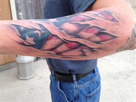 tattered american flag tattoo torn skin and american flag done by me tattoos