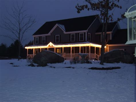 hanging christmas lights on house how to hang christmas lights from gutters