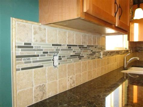 backsplash 4x4 tiles with a large glass and