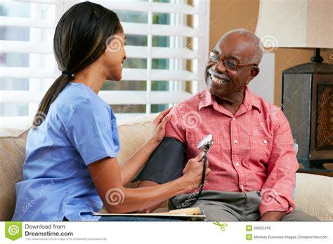 visiting senior patient at home royalty free