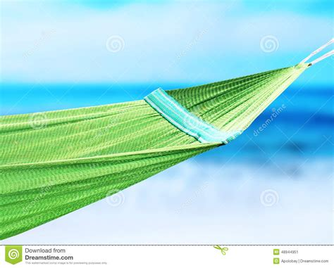 green hammock hanging in the coast stock image image of