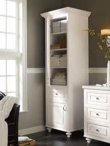 Stand alone linen cabinet adds charm and much needed extra storage