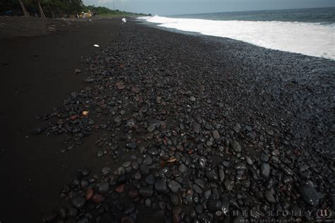 volcanic sand black volcanic sand beach near goa lawah bat cave in