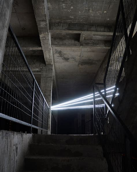 designboom installation jun ong embeds five storey glowing star within unfinished