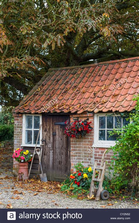 autumnal scene   traditional red brick  pantile shed