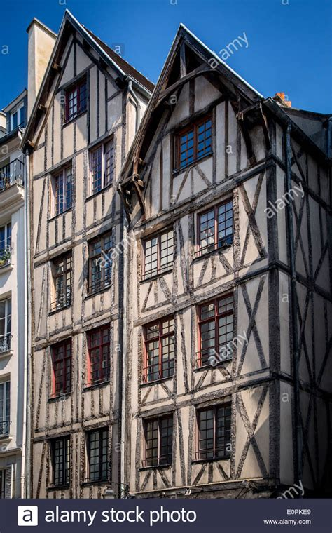 buy a house in paris france oldest houses in paris 15th century half timbered homes along rue stock photo