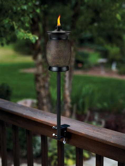 i love that this tiki torch attaches to the deck perfect