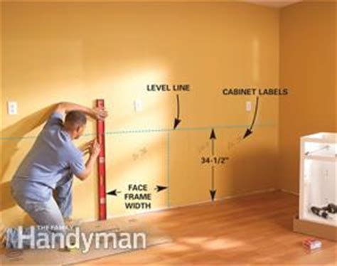 how do you hang kitchen wall cabinets how to install kitchen cabinets family handyman