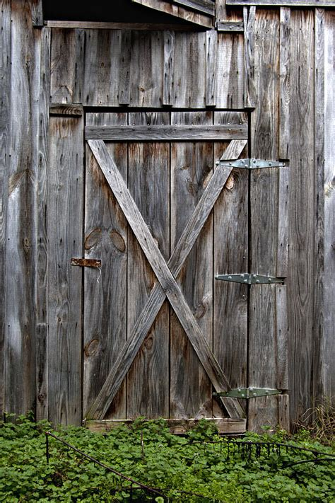 rustic barn doors rustic wooden barn door photograph by reeder