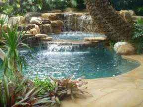 tropical backyard pool waterfall into jacuzzi tropical pool miami by waterfalls