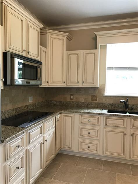 white painted kitchen cabinets with brown glaze