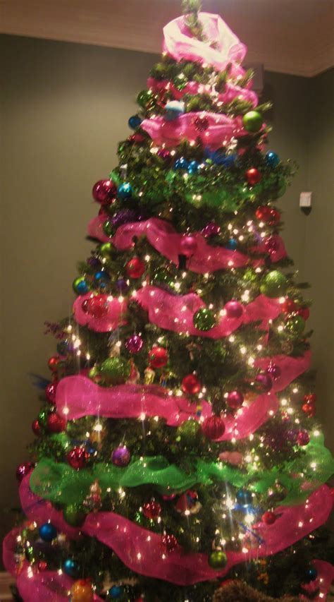 pink and green tree decorations on pink and green mantel and