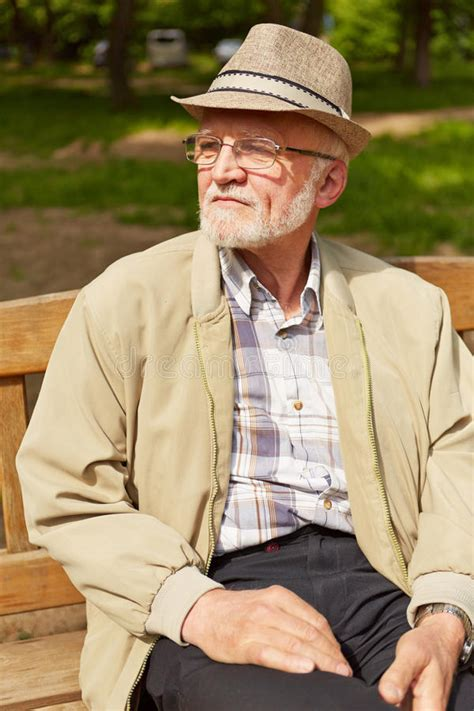old man bench old man sitting on park bench stock photo image 46579764