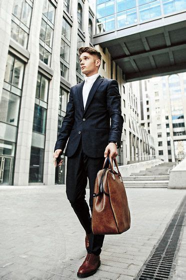 white dress shirt and brown tote bag and burgundy oxford