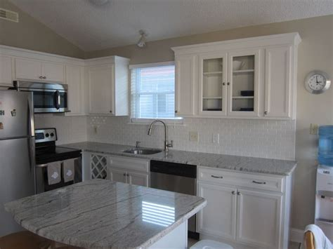 white cabinets with river white granite river white granite shaker style cabinets white subway