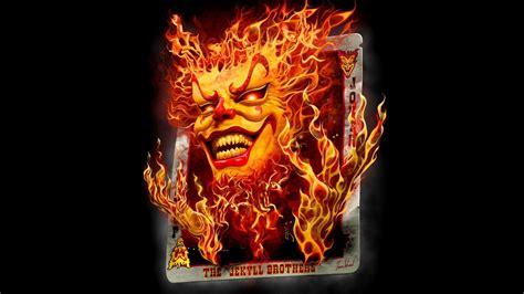 digital art black background minimalism playing cards fire joker smiling devils red eyes