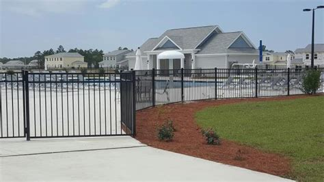 corvias military housing electric gate installation gulf fence construction co