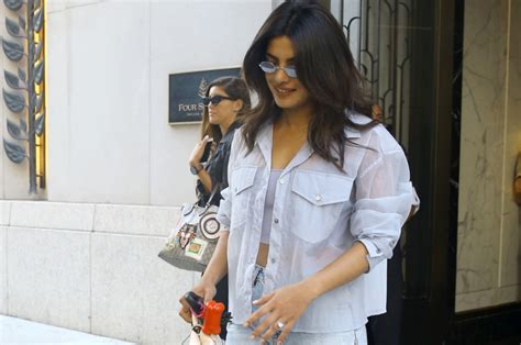 priyanka chopra hiding engagement ring priyanka chopra shows off engagement ring and bold yellow