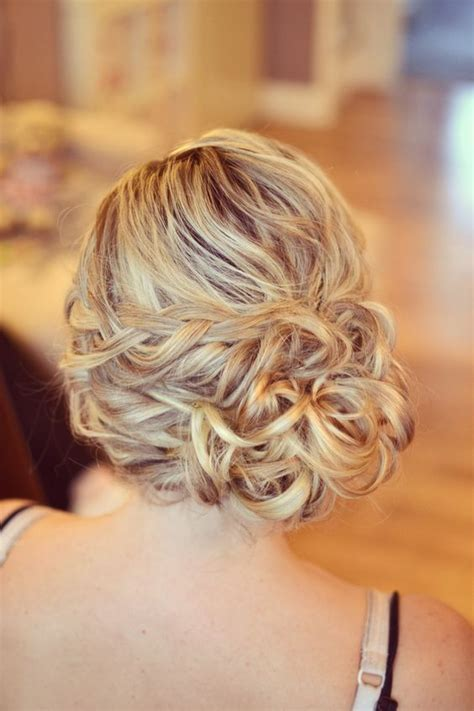 wedding hairstyles buns to the side wedding hair bride side bun curls plaits bridesmaid guest