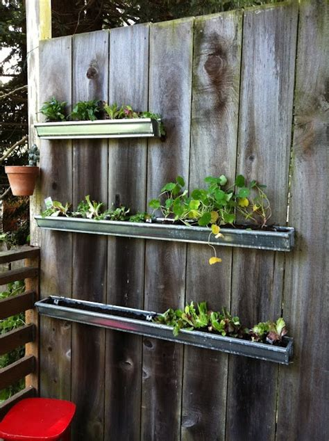 Gutter Planters On Fence by 17 Best Images About Gutter Gardening On