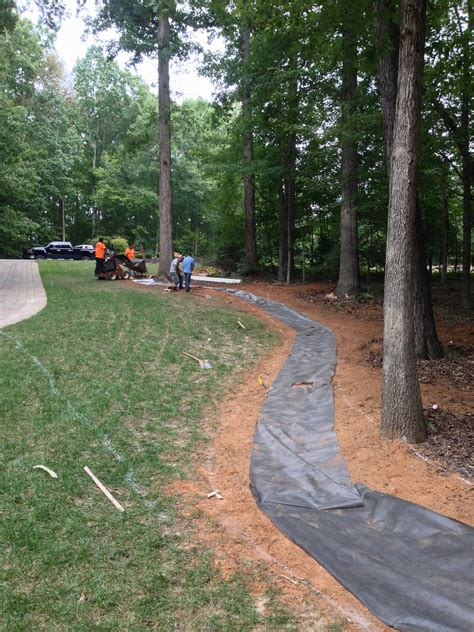 creek bed installation in simpsonville landscaping