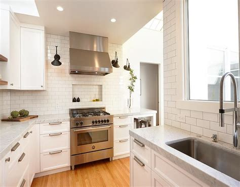 tiled cooktop spice niche transitional kitchen
