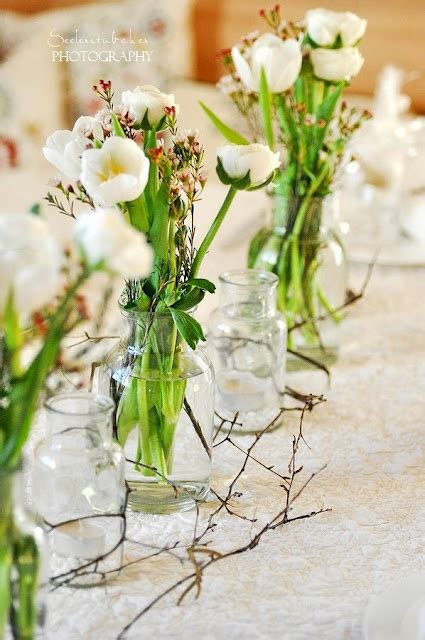 simple flower arrangements for tables a row of sweet and simple flower arrangements for the