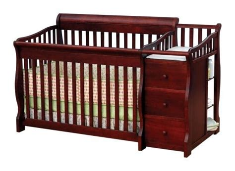 changing crib into toddler bed crib with attached changing table and storage space