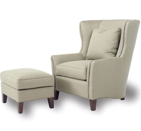 Gray Chair With Ottoman Gray Fabric Back Wing Arm Chair Plus Block Ottoman Four Brown Wooden Legs On The White