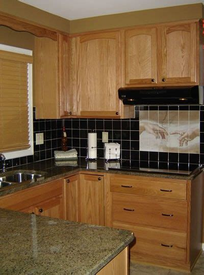 backsplash with oak cabinets and dark countertops the world s catalog of ideas