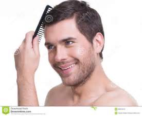 guys combed hair happy young man combing hair stock images image 38291074