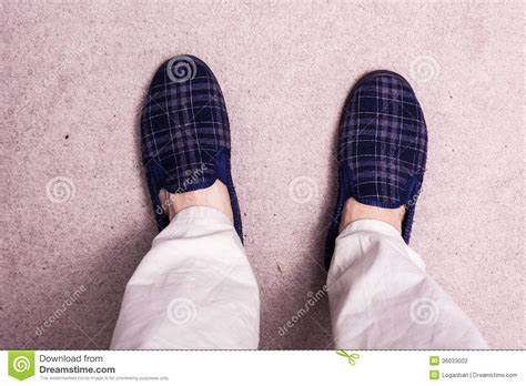 wearing slippers wearing slippers on carpet stock photography image