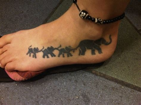family tattoo foot cool black colored elephant family tattoo on foot