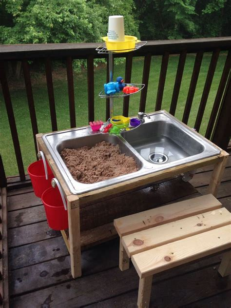 diy sand and water table made from a thrift store kitchen