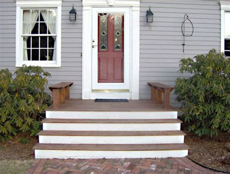 Cape cod front porch with mahogany and white steps