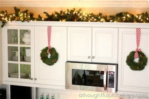 christmas bows on kitchen cabinets christmas home tour holiday decor idea for the top of