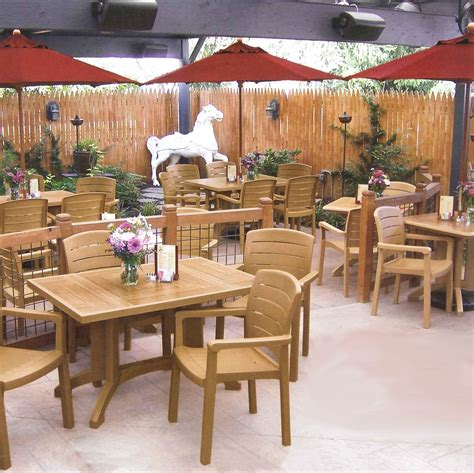 restaurant patio chairs grosfillex acadia classic patio dining set table and