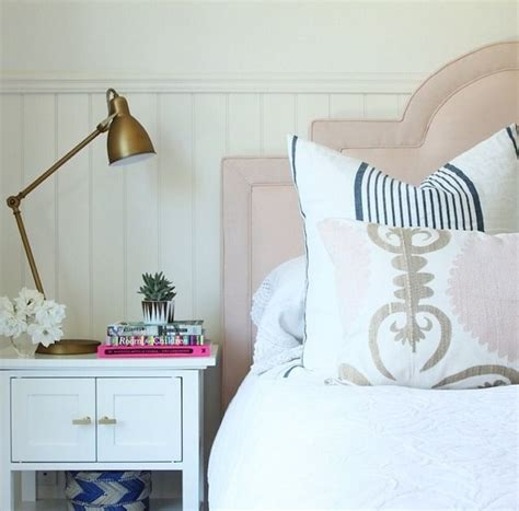 pink upholstered headboard brass industrial task table