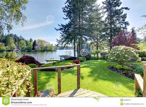 in a backyard lake view backyard with deck and landscape stock
