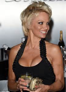pam anderson tattoo removal appears surprised by own cleavage