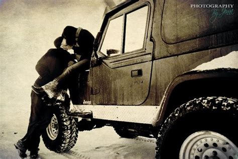 jeep couple kissing on a snowy jeep this seems like a picture we