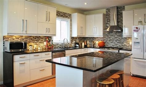 White Kitchen Cabinets Black Granite Countertops Impressive Kitchen Decorating Ideas With White Cabinet And Bamboo Floor Using Glossy Black