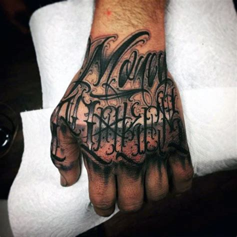 tattoo lettering on hands 40 unique hand tattoos for men manly ink design ideas