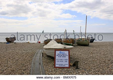 fishing boat hire devon the cove and shingle beach at beer in devon england stock