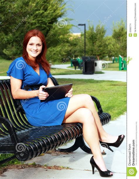 woman on bench beautiful woman on park bench stock images image 20985774