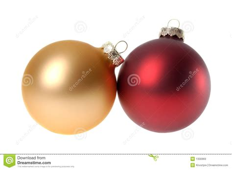 two red christmas ornaments baubles white background