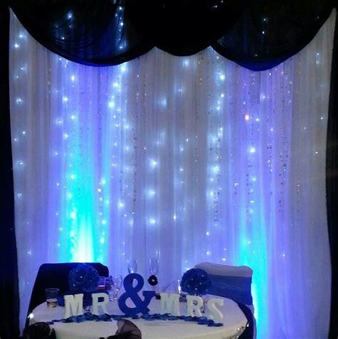 sweetheart table  sheer backdrop royal blue drape