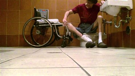 how do guys use the bathroom wheelchair style big guy using little toilet at