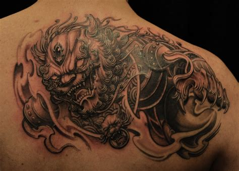 fu dog tattoo sleeve black and grey hannya mask and foo