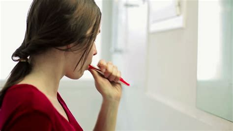 bathroom video clip young beautiful woman brushing teeth with a tooth brush in